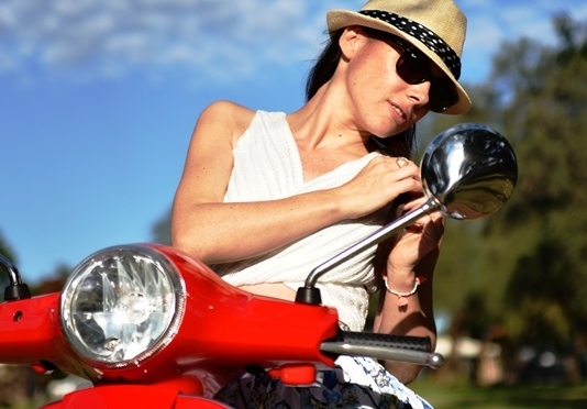 The girl with the red Vespa
